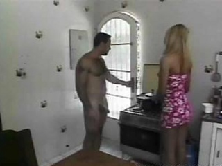Handsome stud fucks a Tgirl on a kitchen table