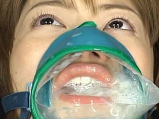 Ruri Anno is fastened down and takes cumshots into this cum facial mask over her mouth and nose.
