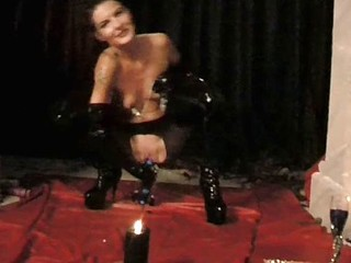 BDSM loving german in latex spreads her pussy with clamps