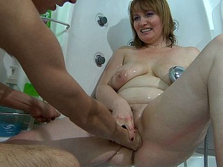 Kinky aged gal with tasty curves gets washed and fisted in the washroom