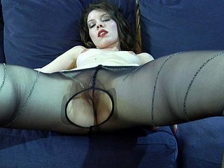 Nude hottie licks sleek nylon hose and uses 'em to pleasure her cookie
