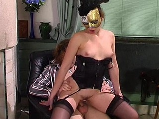 Sultry sweetheart in mask and black nylons giving legjob and fucking like hell