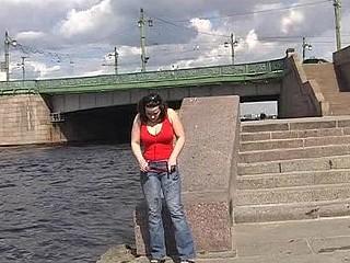 Wet slut urinating riverside in summer
