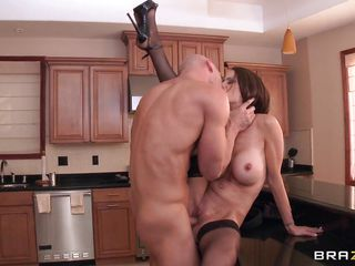 She's a very hot milf with big round perfect tits, short hair, gorgeous face and long sexy legs. Watch her as this bald guy grabs her by the neck, spreads her long legs and fucks her hard making those big tits bounce. This slut loves to take a hard dick from behind so he gives it to her, fucking that round cute ass and then takes his penis out of her tight cunt cumming all over her sexy booty.