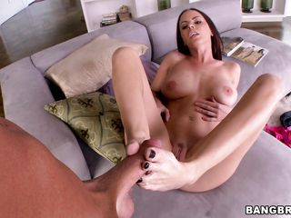 Brandy Aniston is a very hot babe with big tits and a lot of pleasure to offer. She looks pretty horny and she needs to do something naughty so she decides to rub that guys big hard cock with her sexy long feet. Listen to her moaning of pleasure while she is fingering her tight pussy. Will he cum?