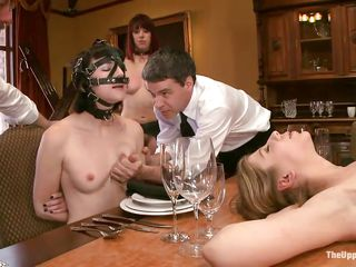 These bitches need to learn some manners at the table! The guys take care of one chick and squeezes her small tits while the other fingers that tied whore laying on the table. He inserts his fingers deep in her shaved and wet vagina with a lot of pleasure. Will these girls learn their manners at the dinning table?