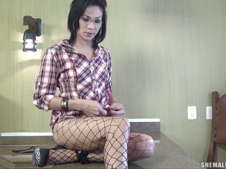 She looks dorky with those glasses but don't let that fool why, Nicolly is a shemale slut and she likes fucking more then anything. Look how she masturbates for us, rubbing that hard penis while keeping her legs spread wide. Is she going to finger her anus now that she cummed?