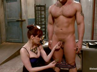 Divine redhead mistress enjoys punishing a muscled guy like this one. She takes her time and does the job with precision. At first the slut uses a lot of laundry pliers on this dude's cock and when she finishes she goes in the back of the room, wonder why?