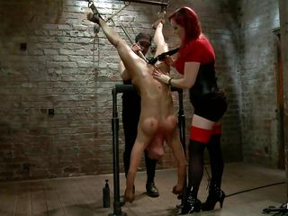 Mz Berlin always gives a punishment in a manner that makes our cocks hard. She has in her front a whore that awaits to be punished and that's all she needs to get back to work. The pretty slut is hanging upside down and those big round boobs are demanding some whipping along with the rest of her body so she whips her and then..