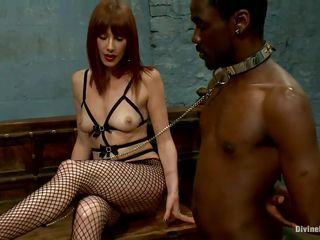Alyssah Simone is a red head bitch who wants to punish this submissive black men for not following her orders. She puts a collar on his neck and swanks his ass. She makes him take off her heels and wants him to lick her pink cunt so she can enjoy his humiliation.