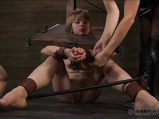 It's just another one of those days for these bitches in which they get humiliated beyond their limits. One of the girl lays tied up on the floor while the other one is putted to insert an oiled anal plug in that sexy ass, with her mouth! He obeys and sticks it in there pretty good.