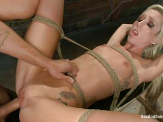 Maia Davis has small pair of tits which is bounded and tied on a table with ropes. It seems to enjoy submission because a guy is playing with her pussy. He starts using a vibrator until her pussy is getting wet and then finger her until she screams. Later, he insert his cock while she moan and ask for more