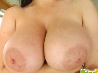 Kristi's massive rack is peaking out of her taut pink top. Two guys bang her snatch during the time that those massive love bubbles jiggle all over the place. Two loads of cum drop on her breasts.