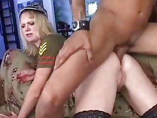 Blonde whore in military uniform and stockings gets her ass rammed hard