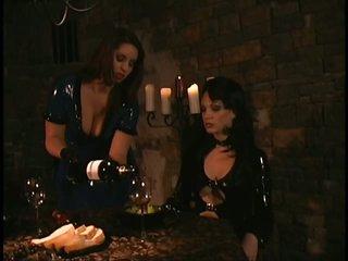 Mistress Jean Enjoys Latex Clad Slaves