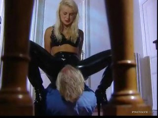Chick in latex pants sits on his face