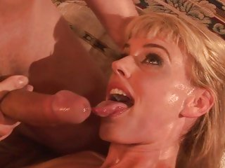 Darryl Hanah gets her face sprayed with hot cum