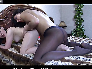 Two lesbo chicks wear nude and black hose to indulge their nylon foot fetish