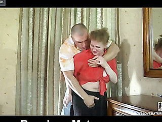 Red sexy mommy baring her large jugs and getting slammed by a horny youthful stud