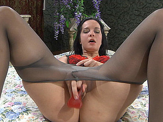 Horny playgirl in grey cotton crotch tights poking a fake penis up her burning hole