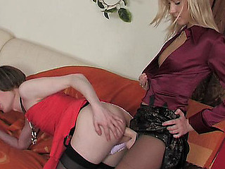 Dressed up sissy guy getting his anus packed with a playgirl