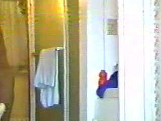 Spy-camera is set up right in front of bathroom's door. Naked woman enters it and becomes part of our great raunchy collection.