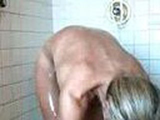 Sour faced bitch having shower, butt naked talking to husband, small tits and a firm tight body, shaved pussy.