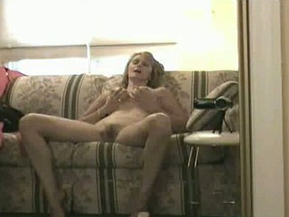 Housewife takes a little break from the daily duties to sit back on the couch, get undressed, and masturbate! She spreads her legs and releases all the tension in her cunt. Her fingers make her cum and she gets back to work!