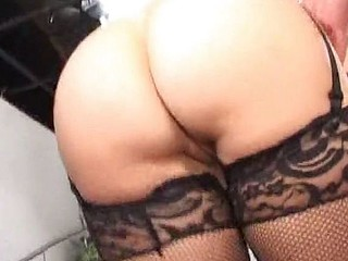 Nasty mature brunette chick in fishnet stockings gets pounded in a threesome