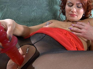 Fiery honey admiring and sniffing her tights in advance of putting to use her vibrator