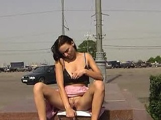 Sexy wench toying her snatch near the road