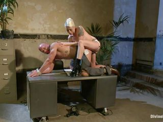 Chad Rock thinks he'll impress mistress Lorelei Lee with his business suit. She's unimpressed. She fucks him from behind on the desk with her black strap-on then flips him over on his back and pounds his ass harder. She strokes the bitch boy's cock and allows him to squirt his spunk all over himself.