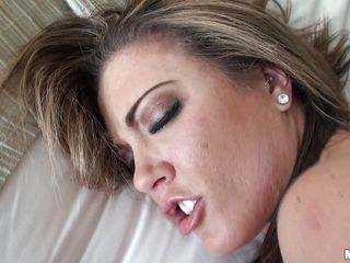 Carmen Valentina is getting fucked... hard and well by her man's big cock. He pounds that sweet pussy from behind, giving her every inch, making her squeal. Then she gets on her back to take some more in that hairless honey hole.