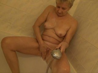 She may be old, saggy and wrinkled but grandma still knows how to masturbate. Here she is under the shower cleaning her old pussy and rubbing it hard. She's a old, horny slut with a lot of love to give so let's watch her as she masturbates for our pleasure. That pussy can still raise some cocks, doesn't it?