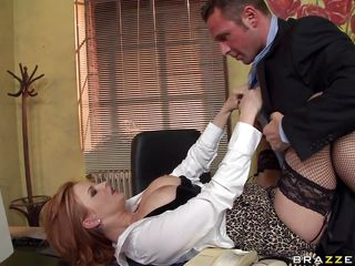 A very hot twenty four year old redhead tells David Perry that if he wants her to stay he will have to fuck her the way she wants. Look at her huge tits and her puffy nipples getting slapped and licked on the desk. Is she going to get some cock in that tight pussy or some cum on those juicy lips?