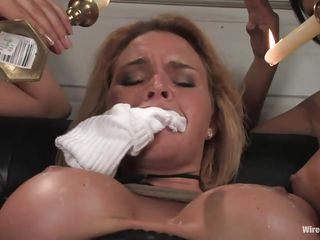 Krissy needs some intense punishment and these asian whores show her what they are capable of. After pouring hot wax on her big round boobs and on her belly and thighs they fuck her shaved tight cunt with a vibrator making her scream, good thing her mouth is gagged with socks. She deserves it and they won't stop soon.