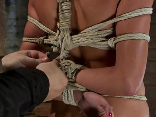 She's a slut and her body is tied up hard. They are going to teach her a hard lesson about sex and after she grabbed by the head and putted to lick that busty brunette ass this chick receives a hard dick in her mouth. She swallows the cock without objections and then starts licking the balls too. Want to see how they will fuck..