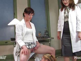 Young Calico is being trained by milfs Nina, Kimberlee Cline, and Nicotine. First, she takes a huge amount of piss in her mouth. Her arms and legs are in rubber so must crawl on all fours like a puppy, whimpering as she does. She gets peed on but lets her own bladder go, earning some face slaps.