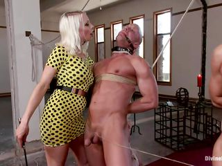 Hot blonde mistress Lorelei has three slaves tied up with strings to each other and mouth gagged. While dirty talking and playing with their nipples, she whips them and hurts their hard cocks. She rubs her tight ass to their dicks and laughs frenetically. They enjoy it so much and are eager for more punishment!
