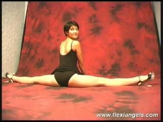 Hot ballerina bending her body for the camera