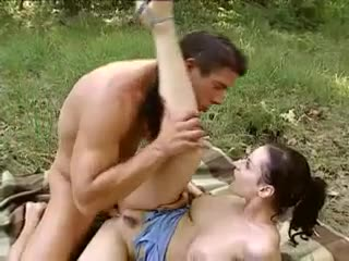 Smoking hot natural girl fucks on blanket in grass