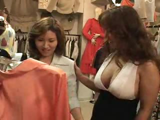 Asians in a clothing store hook up
