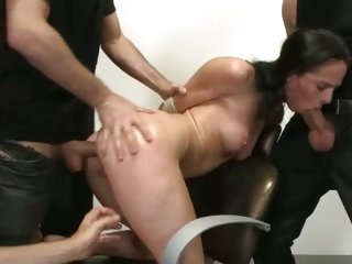 Dominated whore enjoys a hard spit roasting