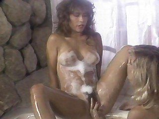 Keep an eye on these raging horny lesbos, as they scrub each other while taking a bath, exposing their bodies naked, full of soap suds, lathering it into their perky tits and longing pussies, both are wet and hot, and they are moaning so loud while experi