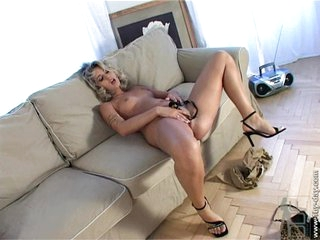 Nude Sarah Blue fondles her hot pussy on the couch