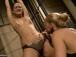 Kathia Nobili spank a sexy babe in the ass