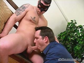 Masked tattooed stud gets blowjob by hunk