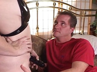 Blond housewife arms herself with a strap-on and fucks her boyfriend in the ass