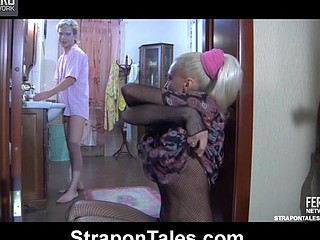 Breasty vixen in a net bodystocking probing a sissy