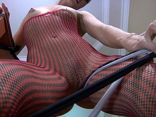 Kinky chick in stretchy two-color fishnets freaking out in a hose maze